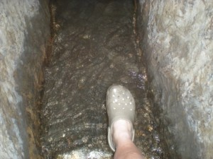 Me stepping into the chilly water running through Hezekiah's Tunnel.