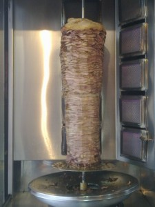 Turkey Shawarma Roasting on a vertical spit. Fun Joel. Israel Tour Guide.
