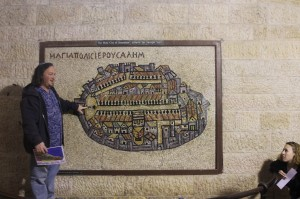In front of copy of the Madaba Map in Jerusalem's Cardo