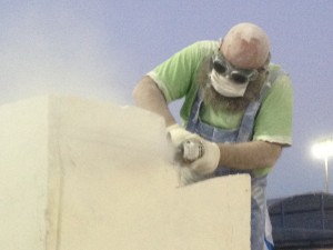 Cutting a limestone block into a sculpture