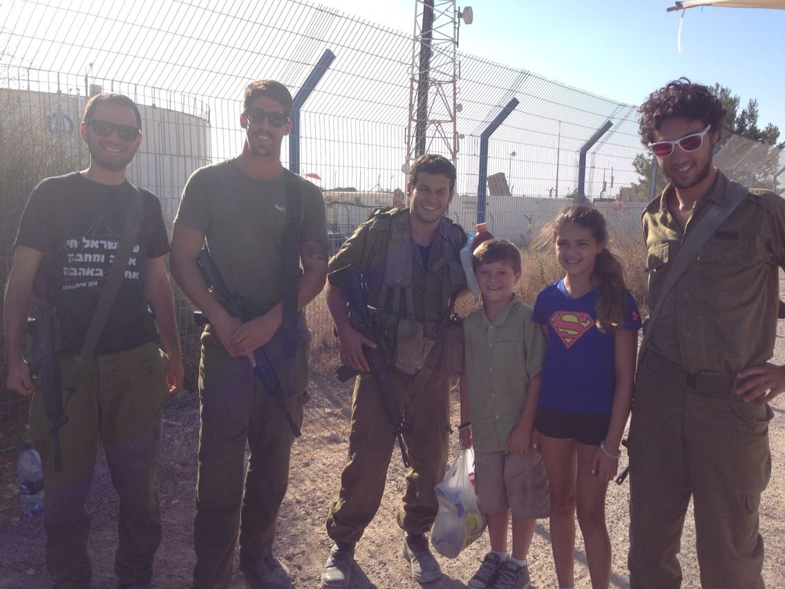 IDF soldiers guarding Iron Dome, on a visit by American tourists