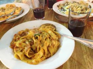 A few bowls of pasta and cups of wine