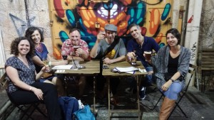 Friends drinking beer in the shuk